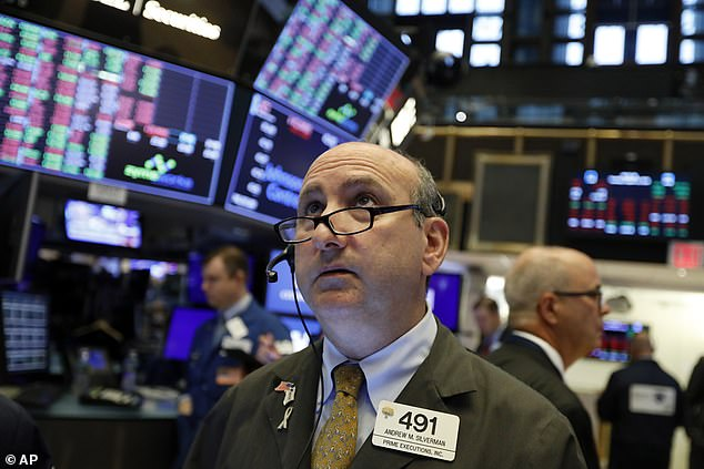 Trader Andrew Silverman works on the floor of the New York Stock Exchange on Tuesday. The threat of a recession doesn't seem so remote anymore, and stocks sank Wednesday