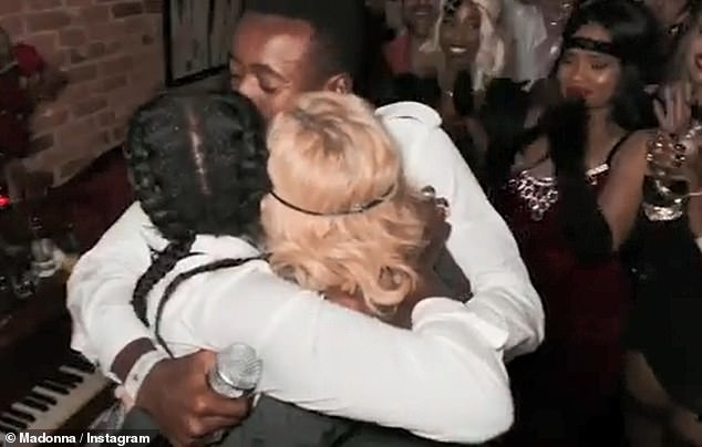Family: Madonna and her two children all embraced each other at the party
