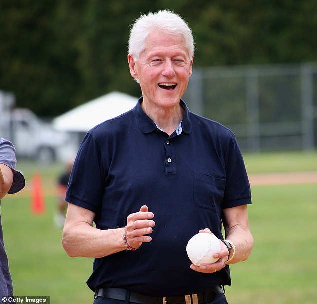 Bill Clinton was pictured smiling as he joined celebrities for a game of softball on the Hamptons