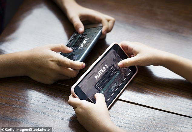Researchers believe children could lose out in learning developmental skills from spending too much time using devices (stock image)