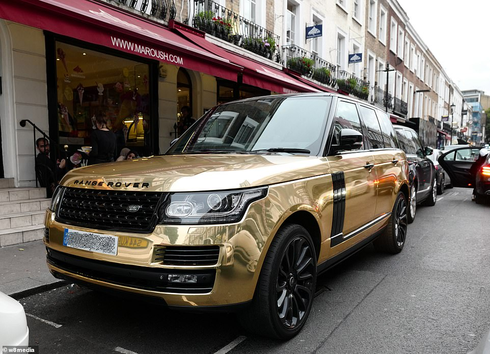 A gold Range Rover parked on the streets of Knightsbridge over the weekend. The cars can cost upwards of £80,000