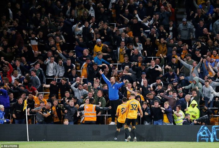 The 22-year-old Portuguese midfielder celebrates his fantastic goal in front of the jubilant home support