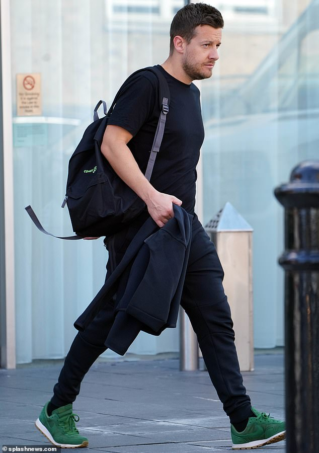 Cool: Chris Ramsay donned a black T-shirt and a pair of skinny black jeans with green trainers