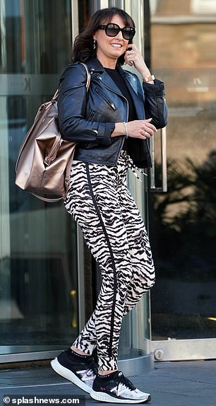 Chilled: Emma Barton rocked a pair of tiger print tracksuit bottoms and a leather jacket