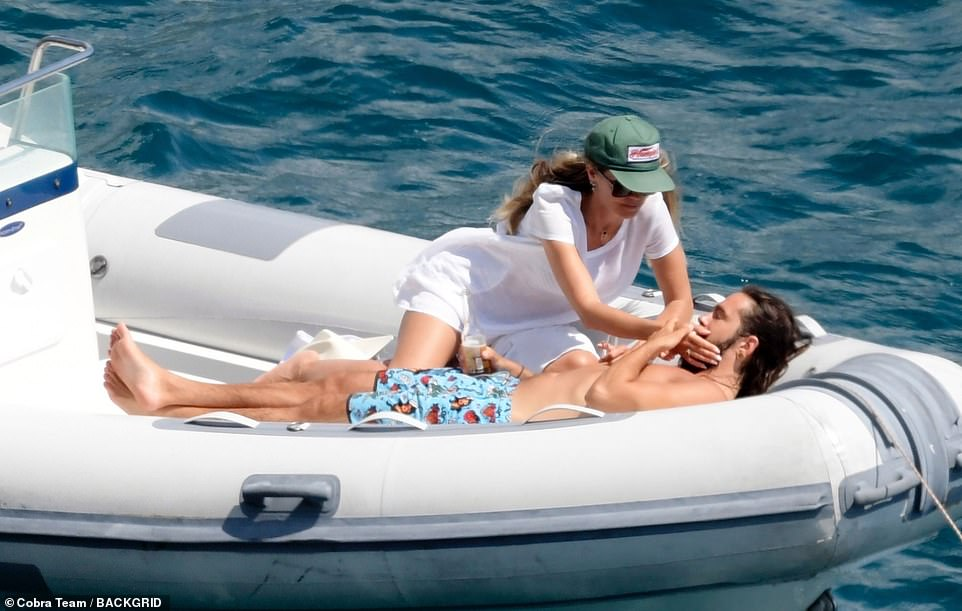 Her guy: Heidi carefully stroked her man's face as he relaxed in the sunshine