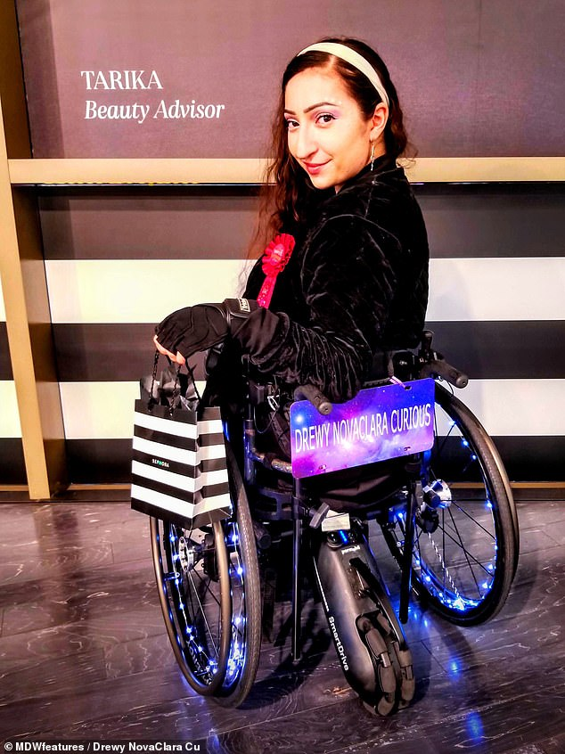 After enduring pitying stares from strangers, Mrs Curious decided to give passers by 'something to look at'. She decorates her wheelchair 'Opal' with 'cool' lights (pictured)