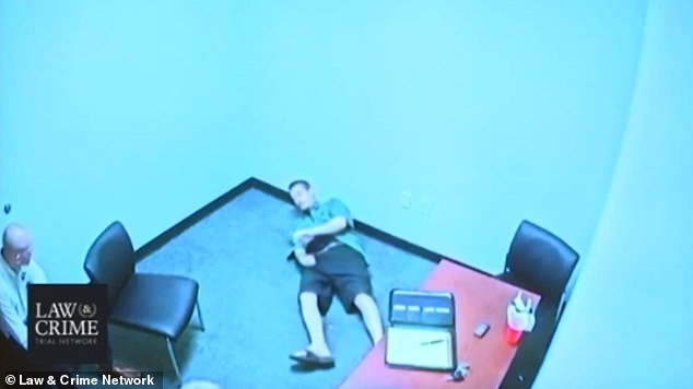 Drejka is shown lying on the floor during his police interview, reenacting shooting the victim