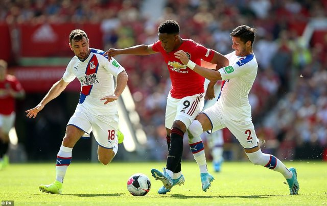 Anthony Martial attempts to make an impact for United but is closed down by James McArthur and Joel Ward