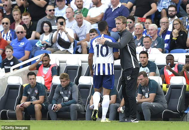 Brighton boss Graham Potter consoled his striker after the dismissal left them with 10 men
