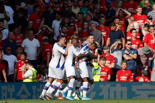 Van Aanholt is congratulated by his jubilant Palace team-mates after his goal secured victory against United