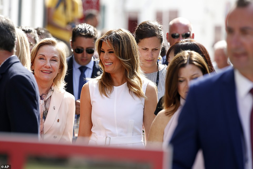 U.S. First Lady Melania Trump and Chile's First Lady Cecilia Morel, left, share a joke while they tour the Basque village of Espelette