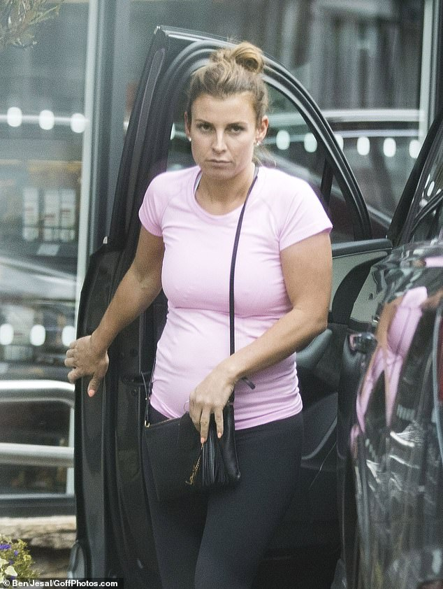 Coleen Rooney was pictured getting out of her car during her shopping trip without her wedding ring