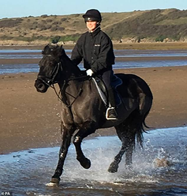 Ellie is pictured riding a horse on her beach. Her family said she had a 'huge love of animals'