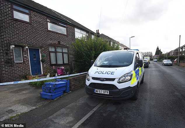 A police cordon at the scene where a 50-year-old man died after being was stabbed at a house in Irlam, Salford
