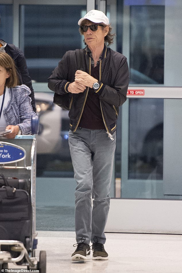 Energy to burn: Despite nearly two years of touring, 76-year-old frontman Mick Jagger looked well-rested as he strutted through JFK airport on Monday