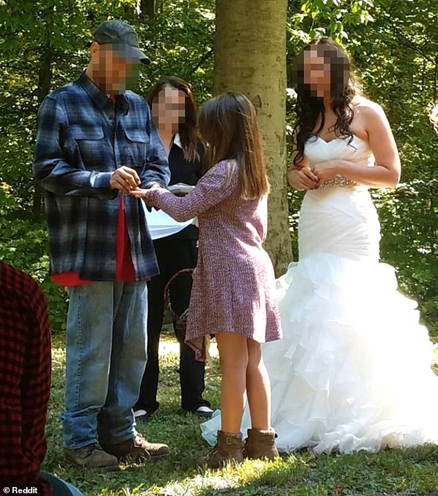 Joining the family: One picture shows the groom giving a ring to a little girl, who is likely the bride's daughter