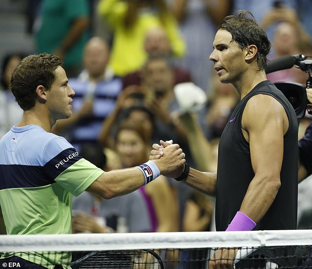 Schwartzman and Nadal shake hands at the end of their quarter-final at Flushing Meadows