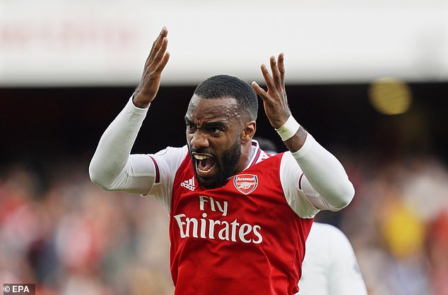 Alexandre Lacazette celebrates after scoring in Arsenal's 2-2 draw with Tottenham last week