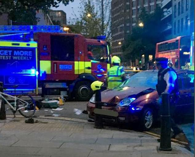 A photo of the aftermath of the hit and run shows the car smashed into a roadside bollard