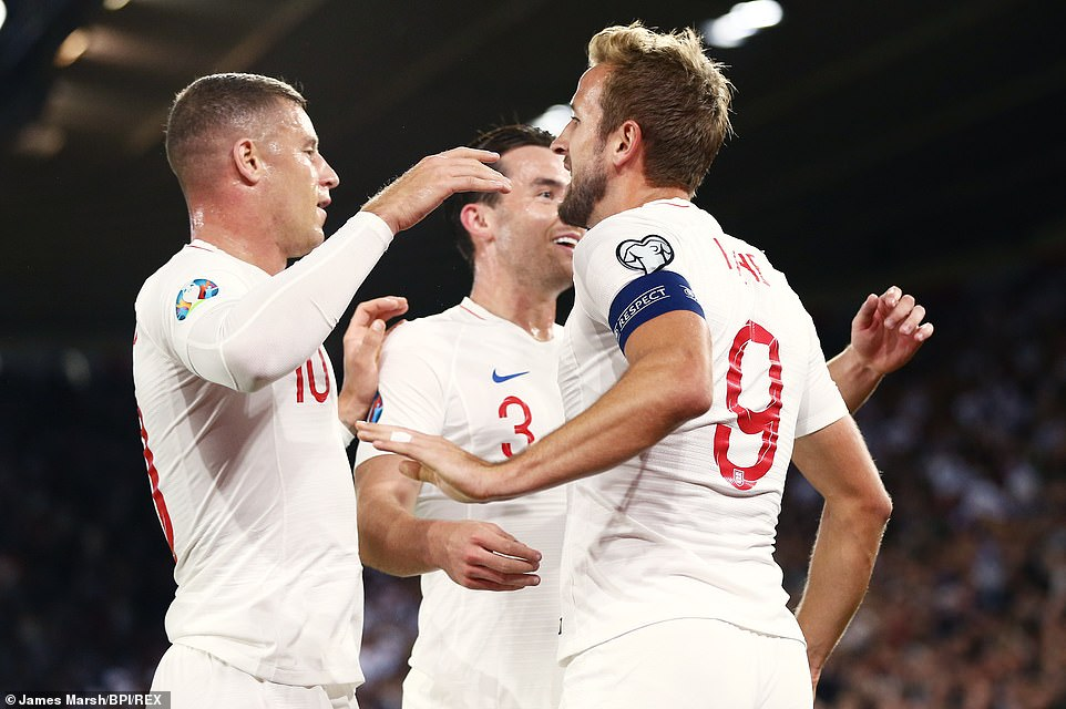 Kane is congratulated by his team-mates Ross Barkley and Ben Chilwell after he managed to find the net