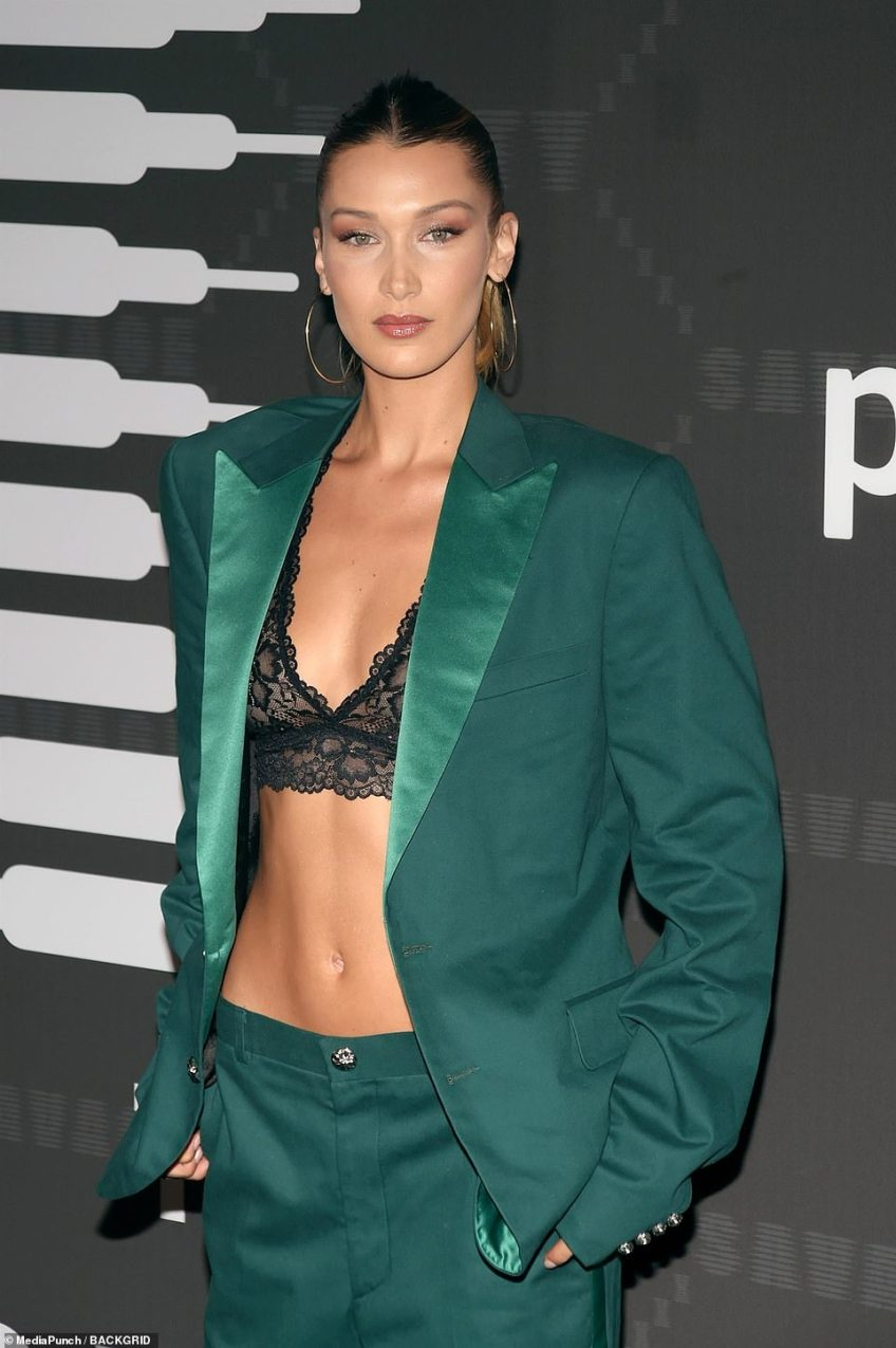 Going green: Bella's sleek suit matched her light green eyes
