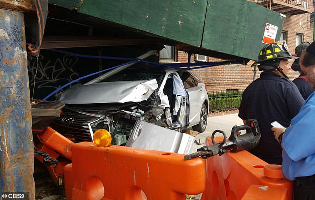 The wreckage from a grayLexus SUV, which crashed into Enzo and killed him on Ocean Avenue and Avenue L in Midwood, New York