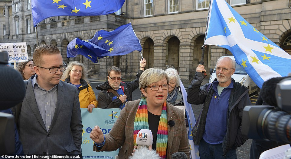 SNP MP Joanna Cherry, pictured centre in Edinburgh today, described the ruling as 'historic' and 'fantastic'