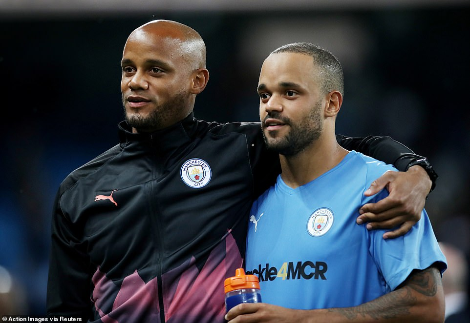 The former Manchester City captain hugs his younger brotherFrancois Kompany (right) following the draw