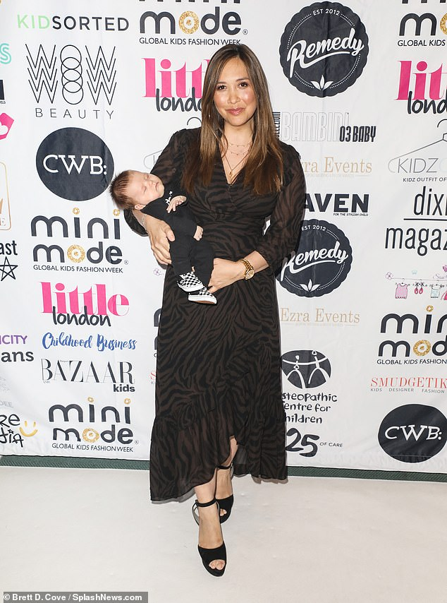 Sweet: Myleene Klass doted on newborn son Apollo as she cradled him to sleep while arriving in style at London Kids Fashion Week event at St Mary's Church in the capital on Friday