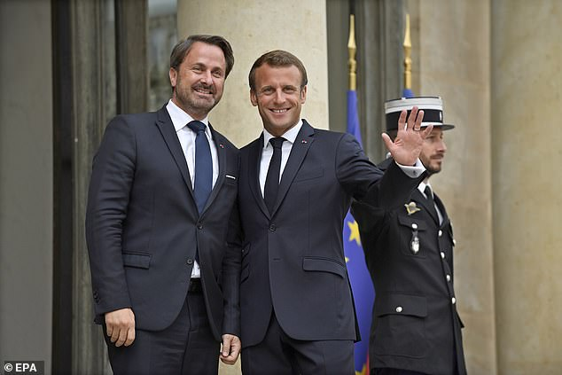 French president Emmanuel Macron (right) hugged and patted Xavier Bettel (left) as he welcomed him to the Elysee Palace in Paris this morning