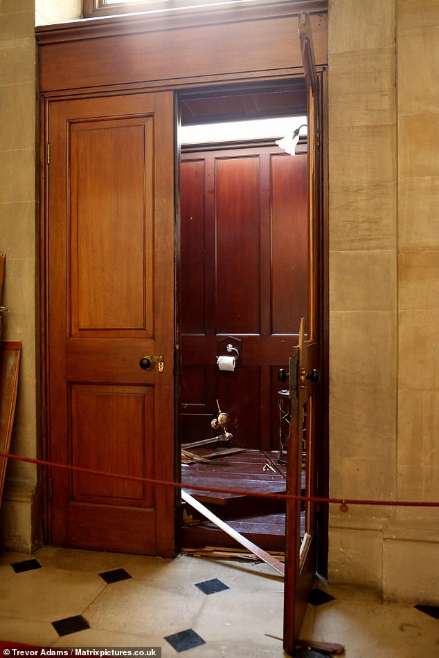 The bathroom was cordoned off after thieves ripped the toilet from its fittings. It had been installed in the stately home (pictured) after appearing at the Guggenheim Museum in New York and 100,000 people queued to visit it