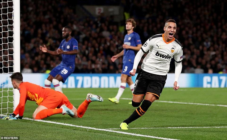 Valencia's Rodrigo celebrates after volleying beyond Chelsea goalkeeper Kepa Arrizabalaga at Stamford Bridge
