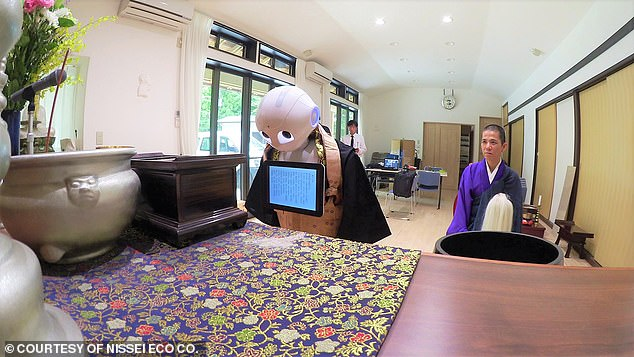 Pepper, the humanoid robot created by SoftBank Robotics, recites a Buddhist sutra at a temple in Yokohama in July