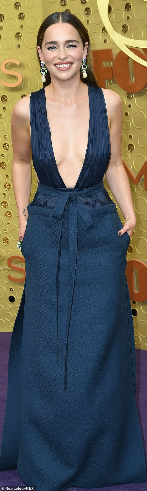 Taking the plunge! Clarke's navy blue dress left little of her fab physique to the imagination