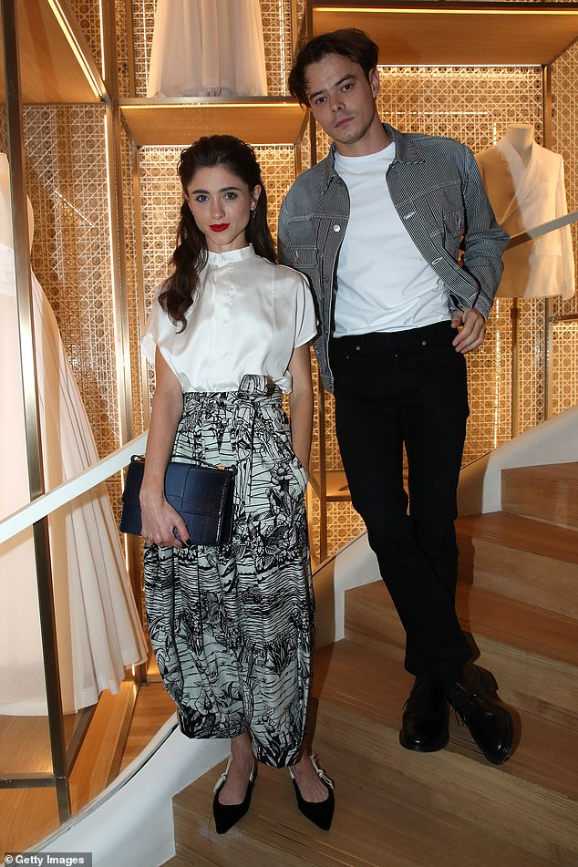 Fashionistas: The Stranger Things couple confirmed their romance in 2017 (pictured at a Dior shop launch in Paris last September)