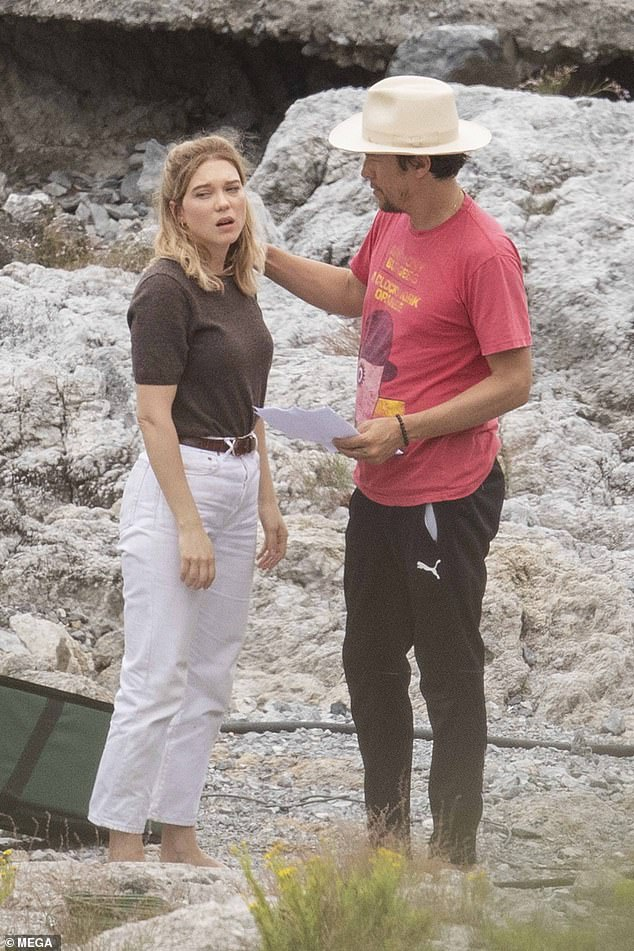 Consoled: The actress, 34, looked upset and was comforted by Cary in-between takes as they shot action-packed scenes on the beach