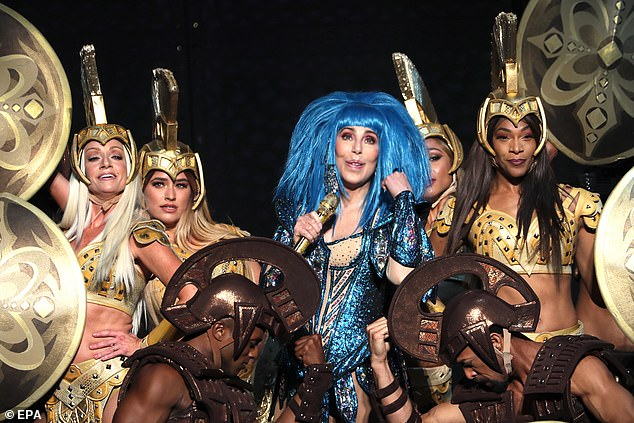 Theme:The set appeared to be Ancient Roman in theme, with Cher surrounded by backing dancers dressed in gold, brandishing shields and wearing helmets