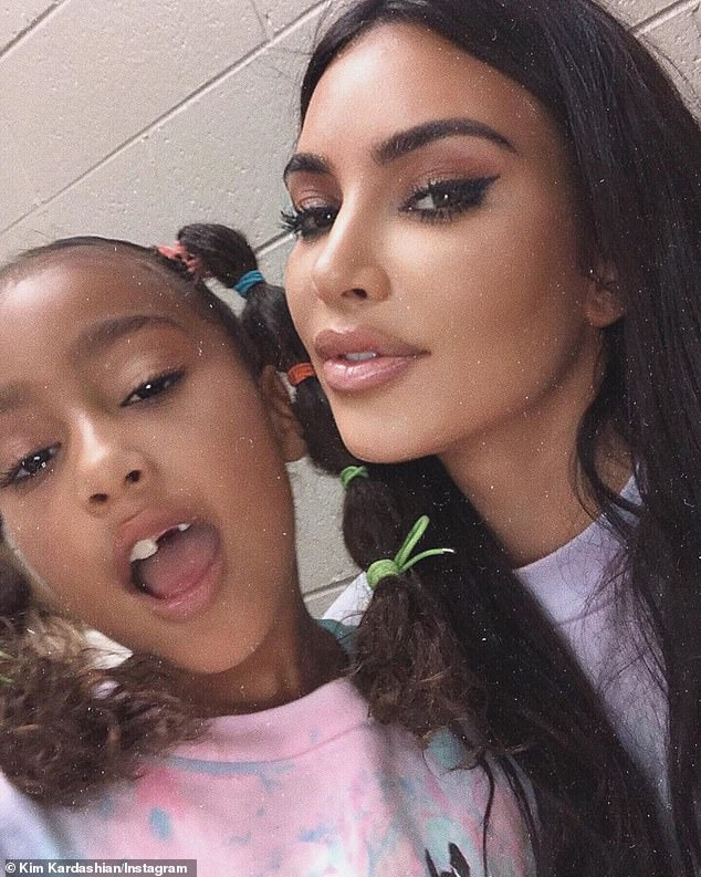 Gappy smile:'North wants you to see she lost her other front tooth!' her mom Kim Kardashian dished on Saturday along with a cute snap of her daughter with her mouth open
