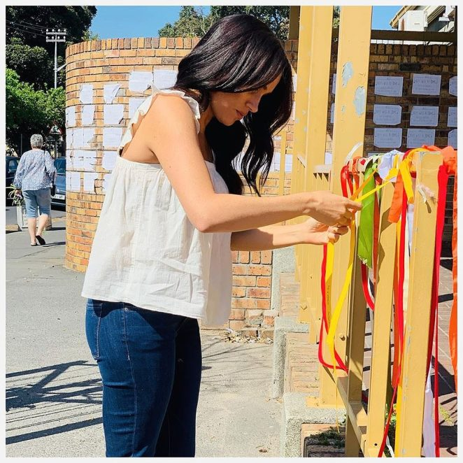 Meghan (pictured) tied an orange ribbon around the painted veranda of Clareinch Post Office, where University of Cape Town student Uyinene Mrwetyana was killed on Saturday, August 24