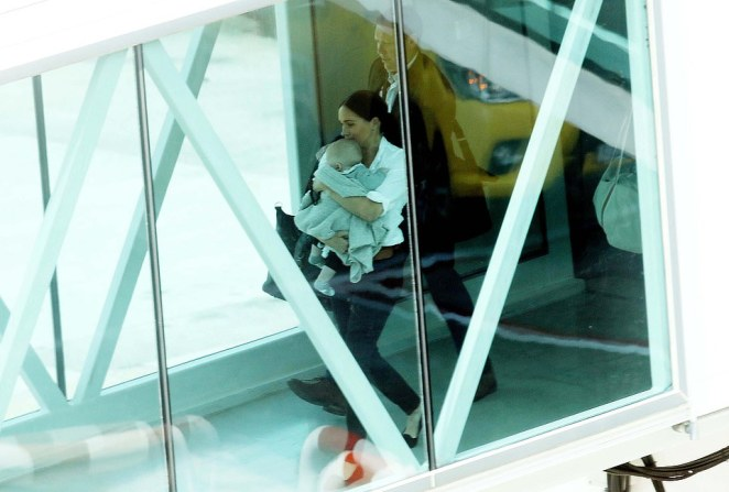 The Duchess of Sussex and baby Archie, pictured together at Cape Town International Airport today before their scheduled British Airways flight, have travelled to Johannesburg for the next part of the 10-day royal tour
