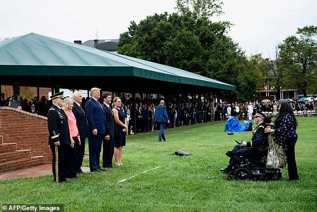 Army Captain Luis Avila sings God Bless America for Chairman of the Joint Chiefs of Staff Army General Mark Milley, Vice President Mike Pence, President Donald Trump, Secretary of Defense Mark Esper and others