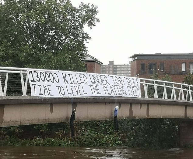 When I saw that banner (pictured) strung across a bridge, complete with dangling mock corpses, to mark the start of the Tory conference, I thought immediately of the kind of savage, ritual punishment meted out by the Sinaloa Cartel