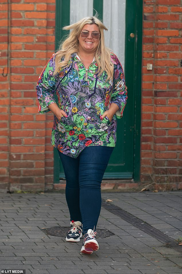 Happy: Sauntering along in the rain, Gemma looked in high spirits as she was seen making her way to her boutique