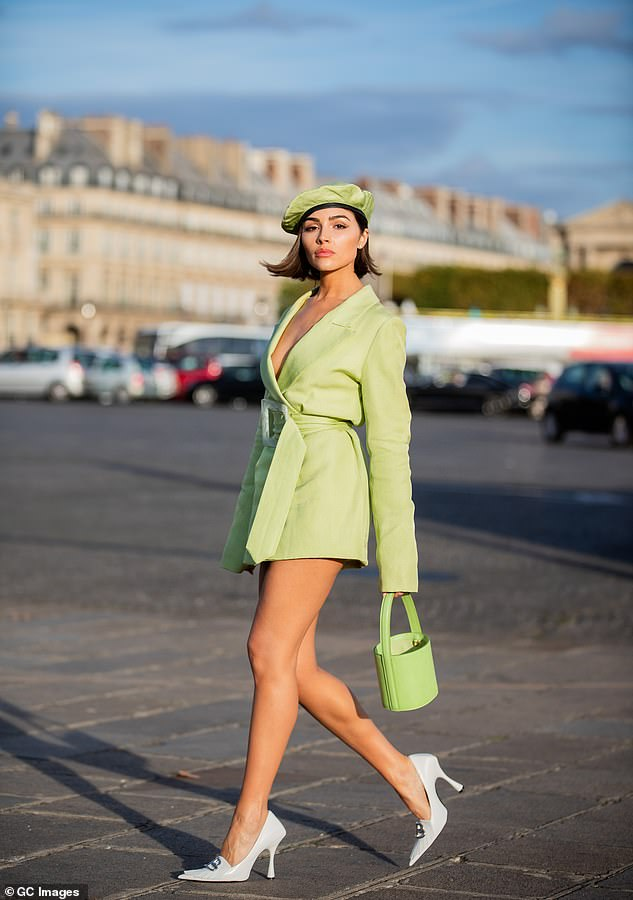Vibes: Two days prior, Olivia commanded attention in an almost all lime green ensemble; she was seen stepping out in Paris rocking a belted blazer dress