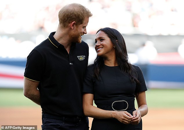 Pictured, Meghan and Prince Harry before the game between the Boston Red Sox and the New York Yankees at London Stadium on June 29, 2019