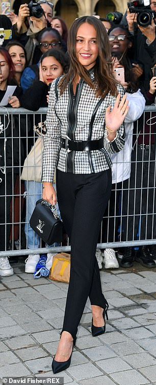 Superstar: Alicia Vikander looked effortlessly chic in a pinstripe jacket and culottes