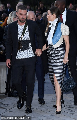 Oh dear: Justin and wife Jessica Biel did their best to shrug off the unwelcome attention as they walked in