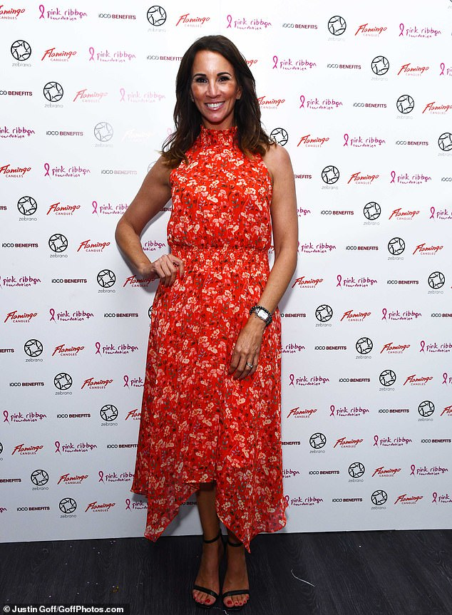 Stylish:Also attending the Pink London event was TV star Andrea McLean who donned a bright red dress with a floral print and a-symmetric hemline