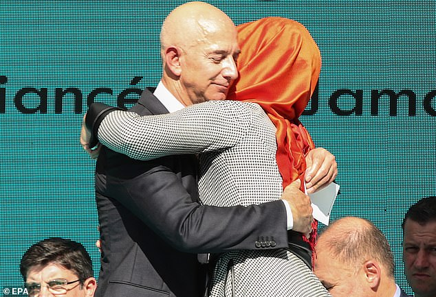 Amazon founder Jeff Bezos embraces Jamal Khashoggi's fiancee Hatice Cengiz at a memorial event in Istanbul today, one year since the dissident Saudi journalist was murdered