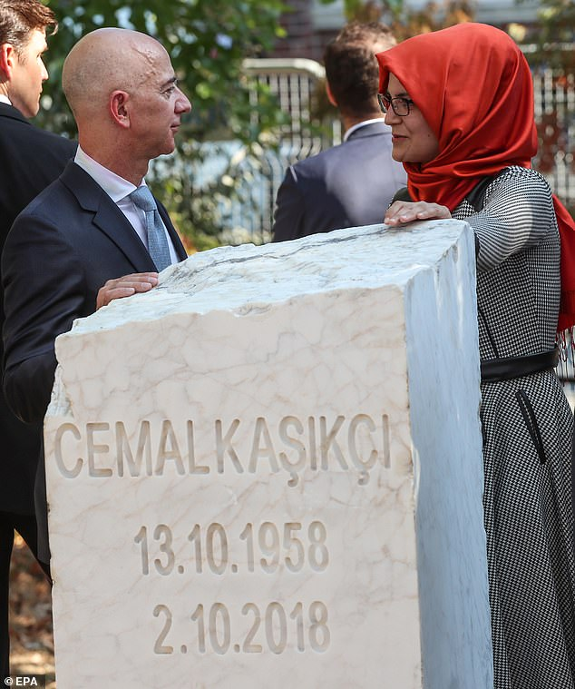 Jeff Bezos and Hatice Cengiz stand over a new memorial stone for Khashoggi which was unveiled today, at a ceremony near the consulate in Istanbul where he was last seen alive